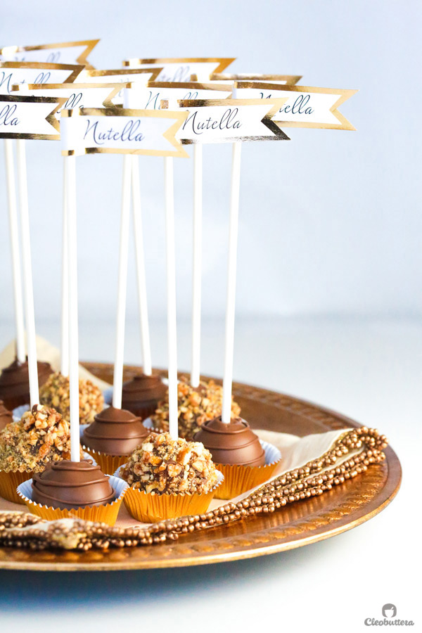 Molten Nutella Pops - Scoops of pure Nutella popped on sticks and dipped in chocolate are the fancy alternative to eating spoonfuls of Nutella straight from the jar.