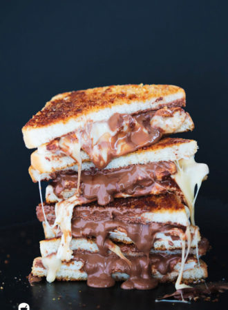Grilled S'mores Sandwich - Graham cracker crusted bread slices sandwiching gooey roasted marshmallows and melted milk chocolate. Insanely delicious!