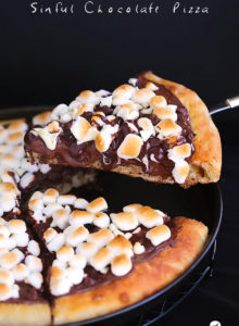Sinful Chocolate Pizza...Soft pizza crust topped with Nutella, 3 types of chocolate and toasted marshmallows. This dessert pizza is a chocolate lover's dream come true.