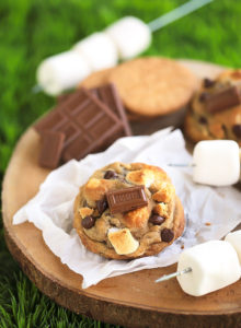 "S'mores Cookies {With a dough made from graham cracker crumbs, milk chocolate chips, mini marshmallows and a square of Hershey's chocolate bar on top...these soft, chewy, gooey cookies scream S""MORES!}"
