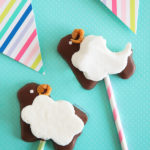 S'mores just got a little cuter! Squishy soft homemade marshmallow on top of a sheep-shaped, chocolate dipped, homemade graham cracker mounted on a stick. Perfect for holidays and special occasions!