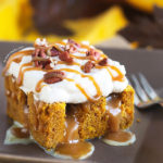 This superbly moist pumpkin spiced cake is so easy to make with the use of a revamped cake-mix. With its pockets of sweetened condensed milk, not-too-sweet caramel sauce, and clouds of caramel whipped cream and pecans, this cake is always a big hit with the crowd!