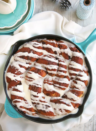 """This giant skillet cinnamon roll with cream cheese glaze is an incredibly delicious """"twist"""" on the classic favorite. Slightly crusty on the outside, irresistibly squishy soft and gooey on the inside."""