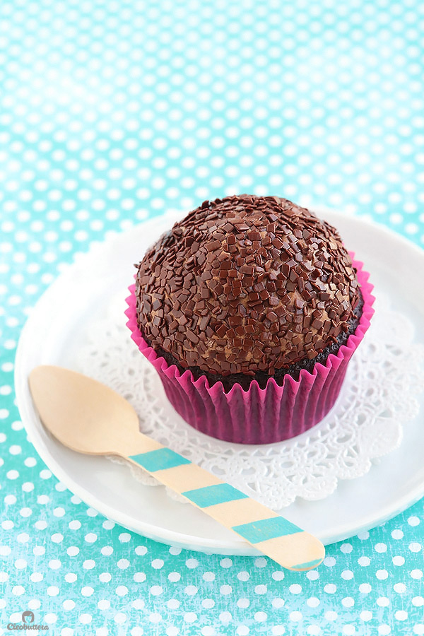 Light and fluffy, moist chocolate cupcake topped with a cloud-like Italian meringue chocolate buttercream and dipped in French chocolate sprinkles. The whole experience is like biting into a chocolate cloud. (Inspired by Kara's Cupcakes famous Chocolate Velvet Cupcake)
