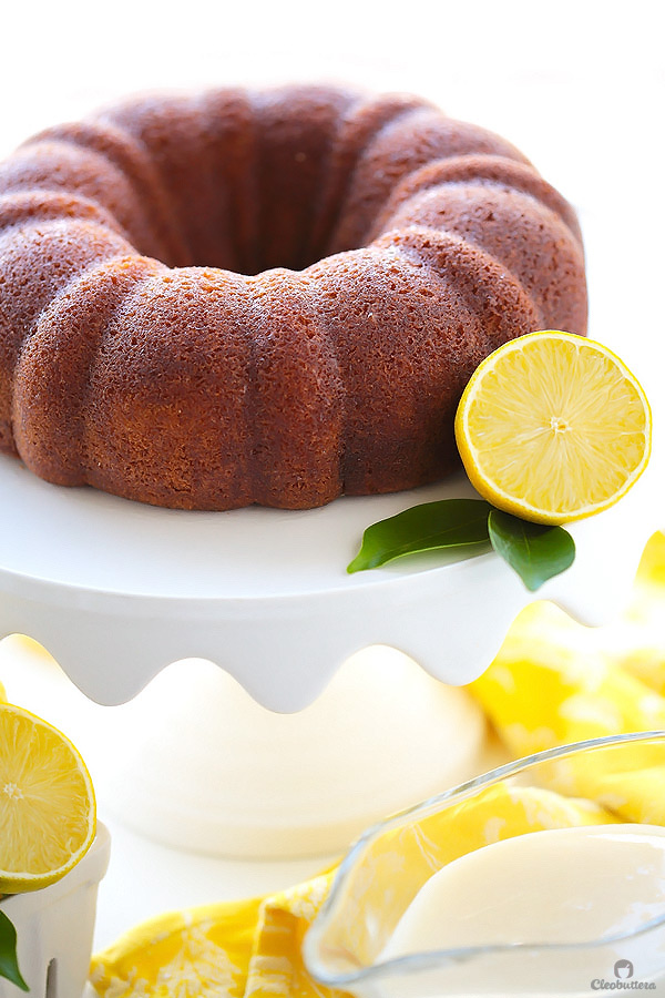 This quadruple lemon bundt cake is as lemony as it gets! A tender sour cream cake is filled with bursts of lemon zest, then brushed with lemon syrup, glazed with lemon cream cheese icing and adorned with candied lemon slices. It's melt-in-the-mouth refreshing (Poppy seeds are more than welcome here!)