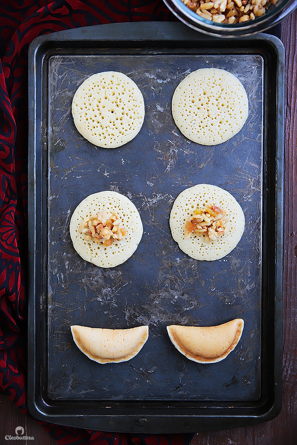 A Middle Eastern favorite, traditionally served during the month of Ramadan! Made from a type of yeasted pancakes stuffed with nuts, fried to crunchy, golden perfection, then doused in simple syrup.
