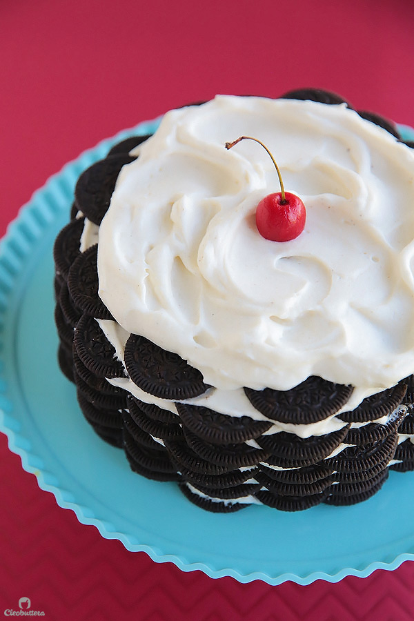Alternating layers of Oreos and Oreo filling-flavored whipped cream make up for one incredibly EASY and delicious cake! This NO BAKE dessert, soften as it sits in the refrigerator and transforms into a cake that tastes like a cross between a giant soft Oreo and an ice cream sandwich. SO GOOD!