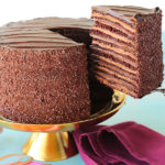 Twelve layers of chocolate cake filled with alternating layers of silky chocolate pastry cream and rich fudgy chocolate frosting.   This 6-inch tall mega cake might just be the best chocolate cake you'll ever taste.