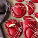 Get your Red Velvet Cake (frosting and all) in cookie form! These irresistibly soft and chewy red velvet cookies stuffed with real deal cream cheese frosting, are pretty amazing!