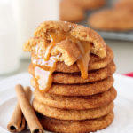 Soft, thick and chewy snickerdoodles, bursting with flavor from the addition of browned butter and an irresistible gooey homemade caramel center!