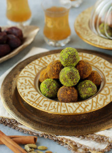 Delightfully soft date balls studded with crunchy chunks of biscuits and flavored with warm spices.  Make them with Lotus biscuits for that caramelized gingerbread flavor it's loved for, or Digestive biscuits and cardamom to go with that perfect cup of Arabic coffee.