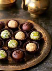 The coolest new way to enjoy halawa! Easy, homemade Halawa (Tahini Halva) made from scratch and revamped into the most elegant little truffles.  Roll them in either pistachios, sesame seeds or dunk them in glorious chocolate.  Plus...recipe VIDEO included!