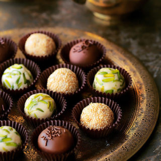 The coolest new way to enjoy halawa! Easy, homemade Halawa (Tahini Halva) made from scratch and revamped into the most elegant little truffles. Roll them in either pistachios,sesame seeds or dunk them in glorious chocolate. Plus...recipe VIDEOincluded!