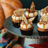 Soft pumpkin cupcakes infused with nutty brown butter, filled with cinnamon toffee sauce, topped with brown butter cream cheese frosting and shards of pumpkin spice toffee.