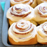 An amazing recipe for squishy soft cinnamon rolls with a super fluffy and tender texture and a gooey filling that caramelizes in the bottom.  A halo of perfectly sweet cream cheese frosting ties everything together.   A brilliant Asian technique called Tangzhong, ensures moist, airy rolls that stay soft for days.