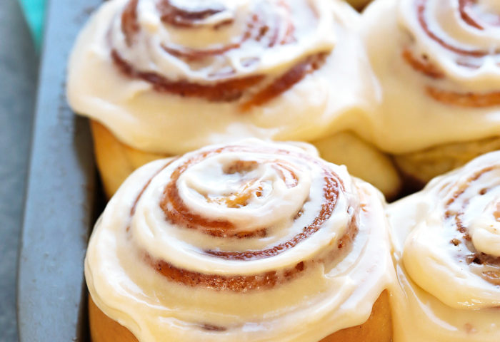 An amazing recipe for squishy soft cinnamon rolls with a super fluffy and tender texture and a gooey filling that caramelizes in the bottom. A halo of perfectly sweet cream cheese frosting ties everythingtogether.  A brilliant Asian technique called Tangzhong, ensures moist, airy rolls that stay soft for days.