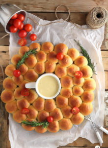 Ring around a Rolls -Bite-sized dinner rolls ring served with a cheese fondue dip. Perfect for the holidays and special occasions!