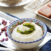 The easiest and quickest way to make a shortcut, Arabic-style clotted cream, perfect for topping or filling into your favorite Middle Eastern desserts.