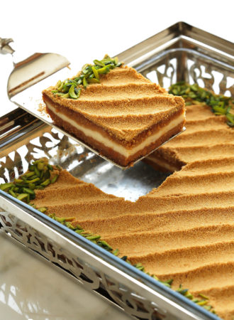 A uniquely delicious basbousa cake with notes of toffee and caramel that come from toasted milk powder; a genius ingredient that elevates the taste of anything it touches.  Filled with a cream center and soaked with sweetened condensed milk...this basbousa is sure to make your tastebuds sing.