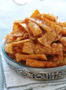 Classic Egyptian fritters with a blistered, bubbly exterior and an irresistible flakey crunch. Glistening with sugar syrup, these golden strips of joy will become aninstantfavorite!