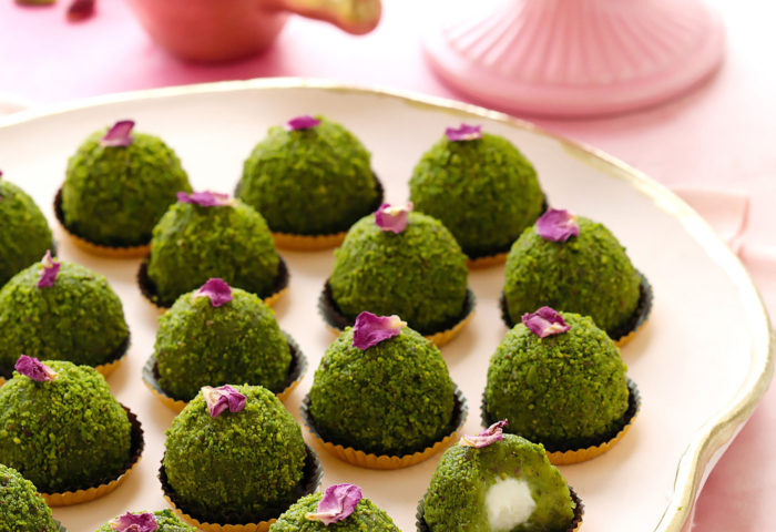 A traditional Middle Eastern delicacy with a new twist! Asemolina-based pistachio concoction, with an ashta cream surprise center, is turned into bite-sized truffles for the ultimate party treat! A simpler, traditional methodalsoincluded. Plus...recipe VIDEO at the end of the post!